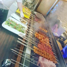 Lamb shish, lamb adana, chicken shish on grill